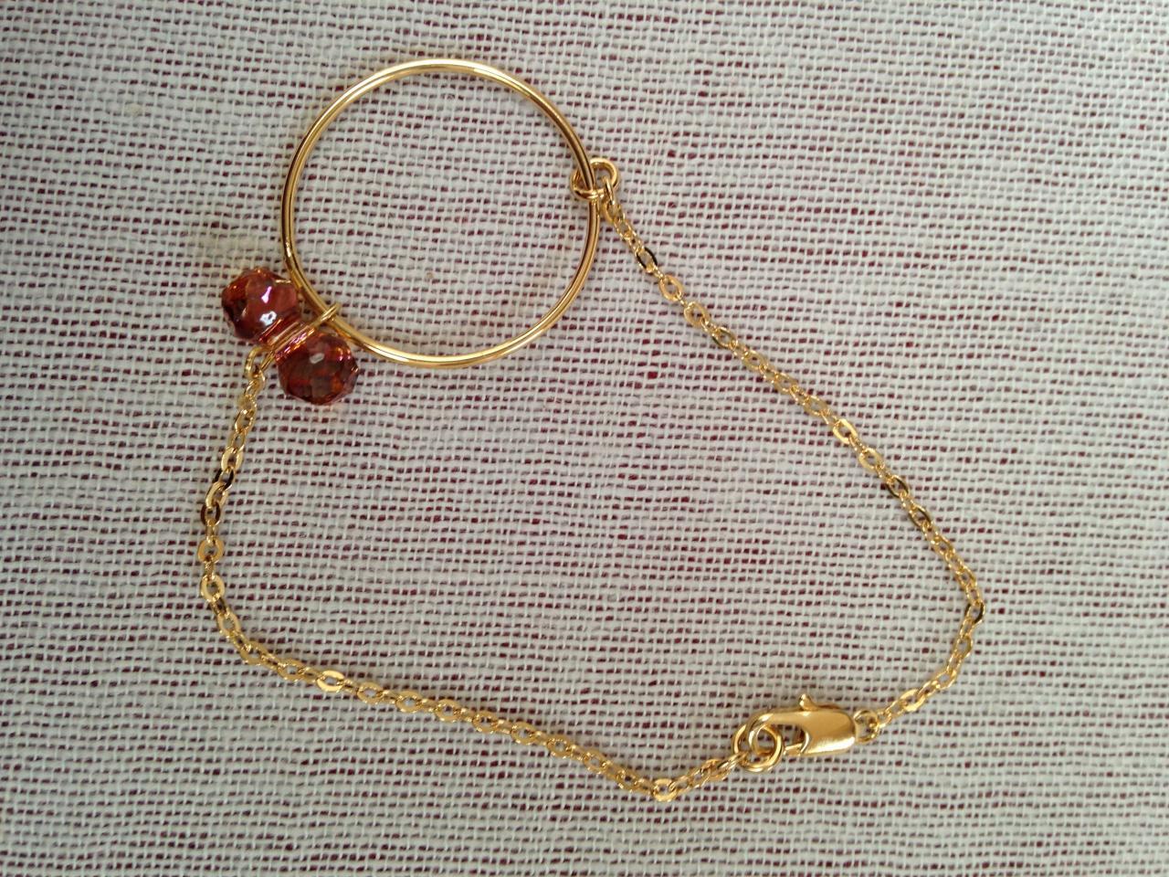 Noeud en cristal de Swarovsky et anneau MM à 22€