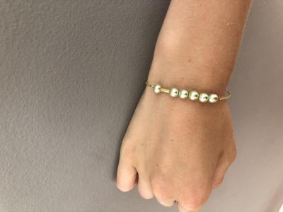 Bracelet perles nacrées et mini tube