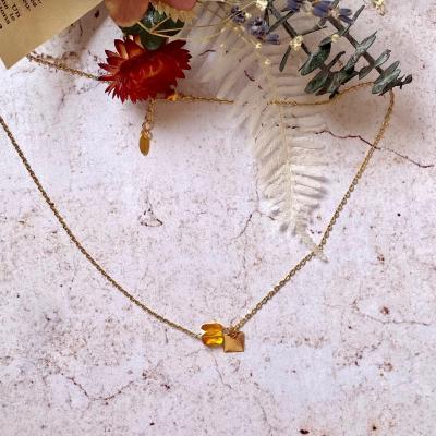 Collier avec pendentif en cristal et mini carré