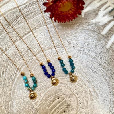 Collier perles naturelles et pendentif coquillage plaqué or